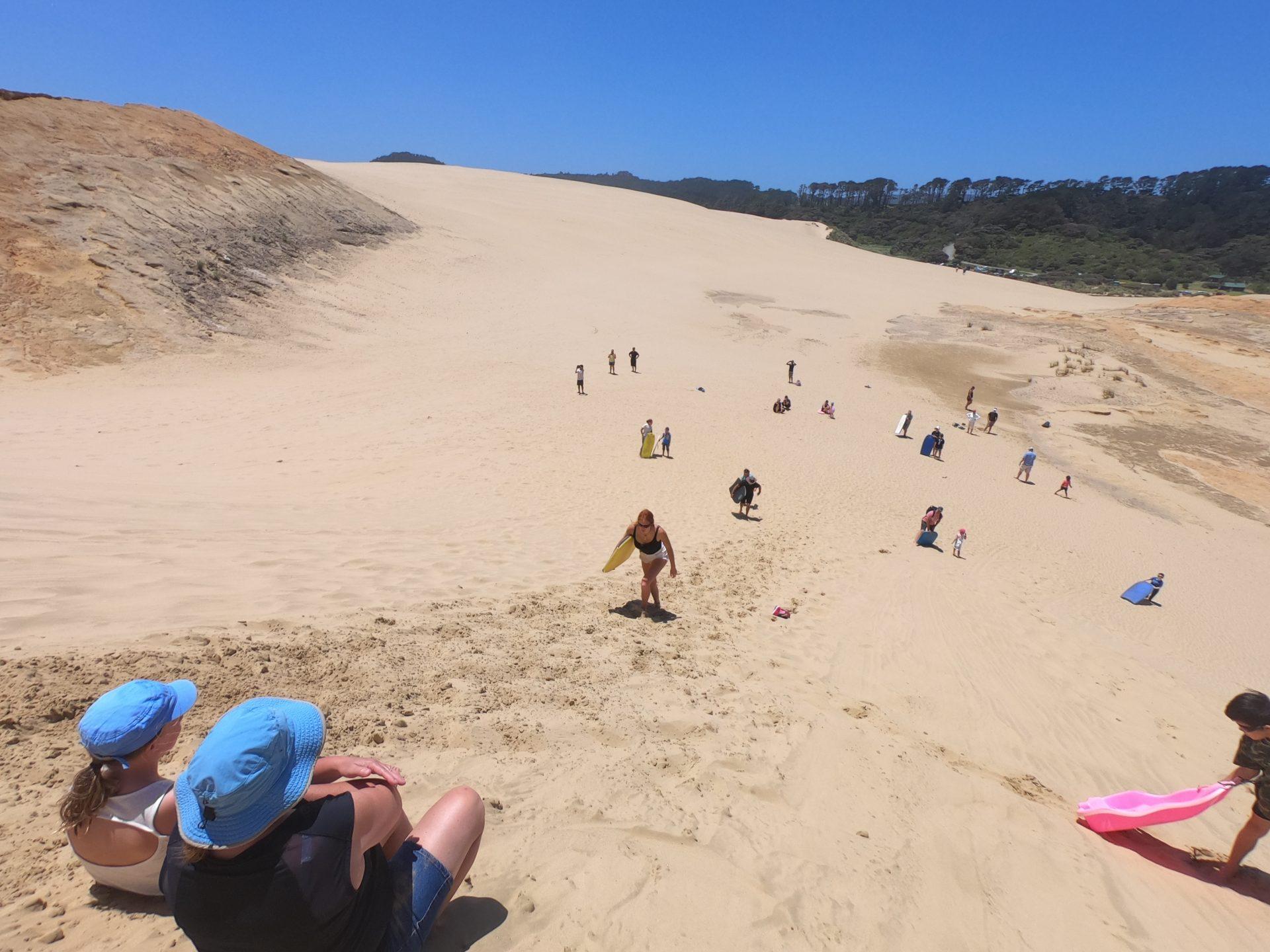 Sandboarding the Te Paki Sand Dunes of New Zealand